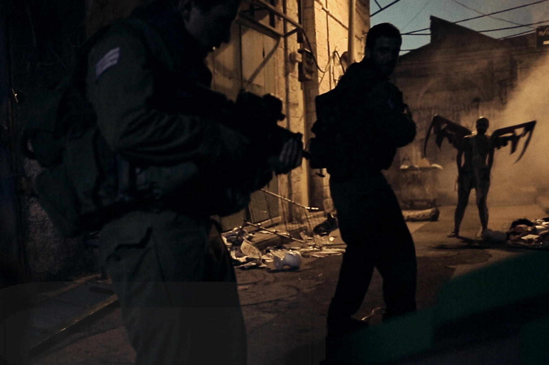 Soldiers vs winged demon figures in Jeruzalem (2015)