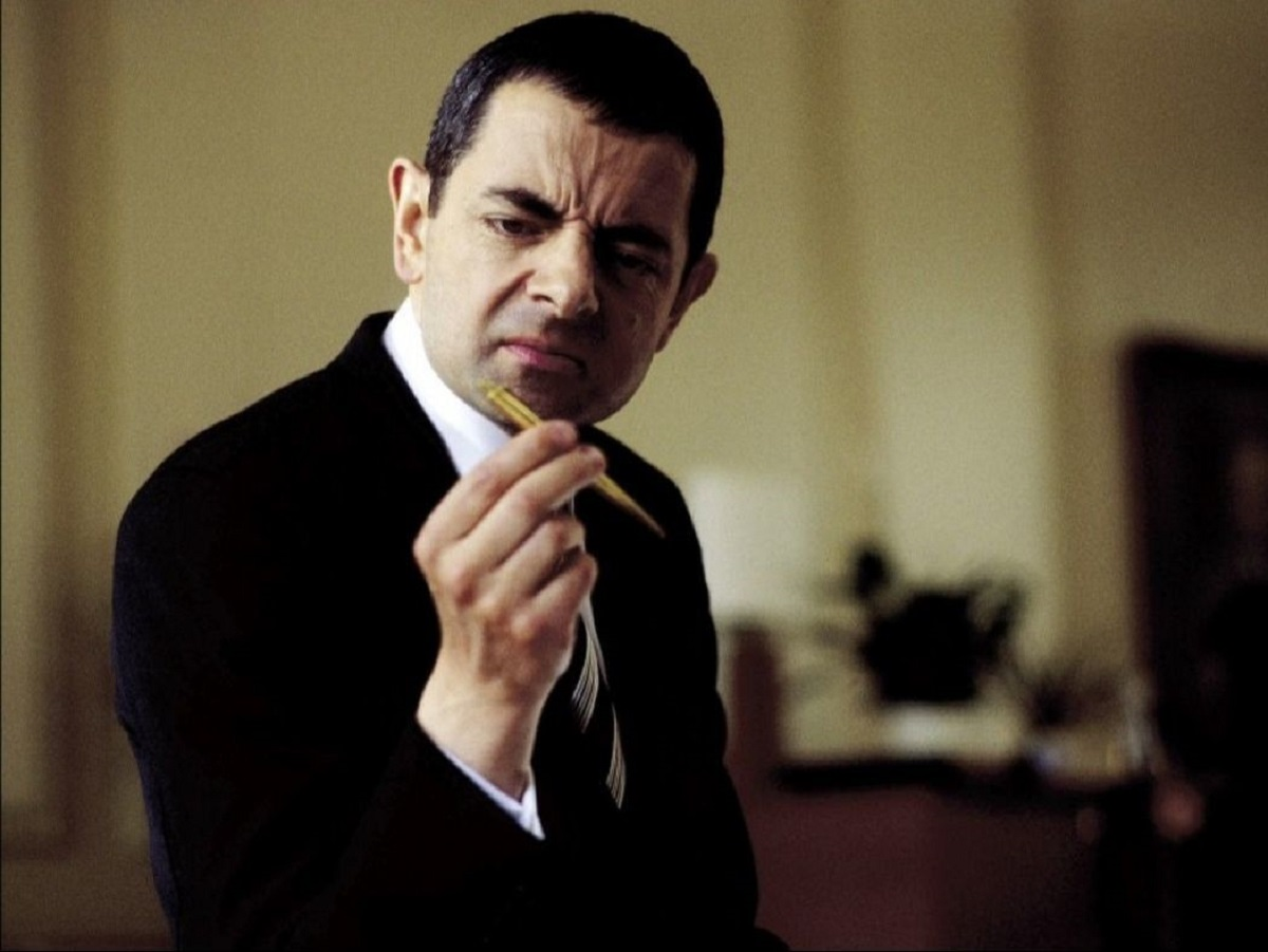Rowan Atkinson as Johnny English (2003)