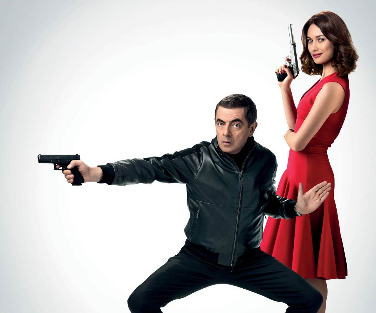 Johnny English (Rowan Atkinson) and Ophelia Bhuletova (Olga Kurylenko) in Johnny English Strikes Again (2018)