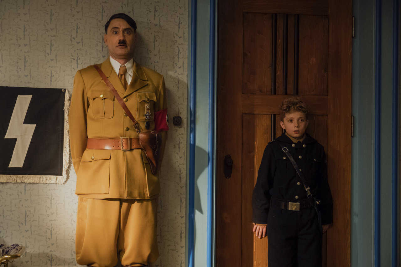 Young Johannes 'Jojo' Beltz (Roman Griffin Davis) and his imaginary companion Adolf Hitler (Taikia Waititi) in Jojo Rabbit (2019)