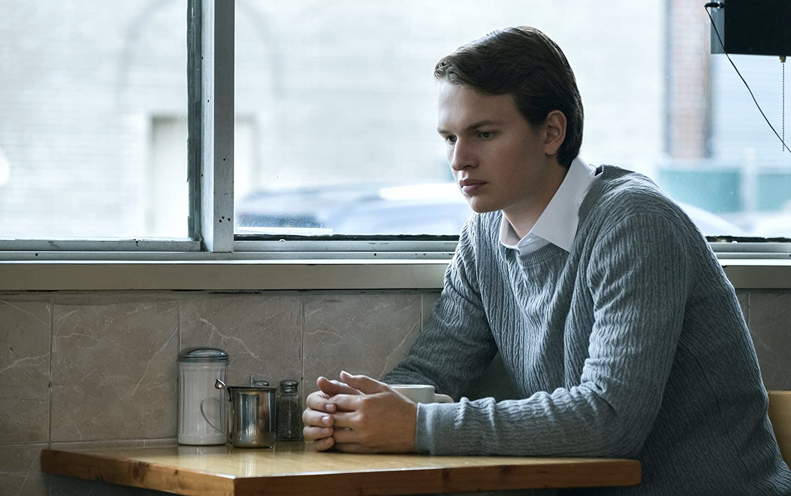 Ansel Elgort as Jonathan and John, two brothers living in the same body in Jonathan (2018)
