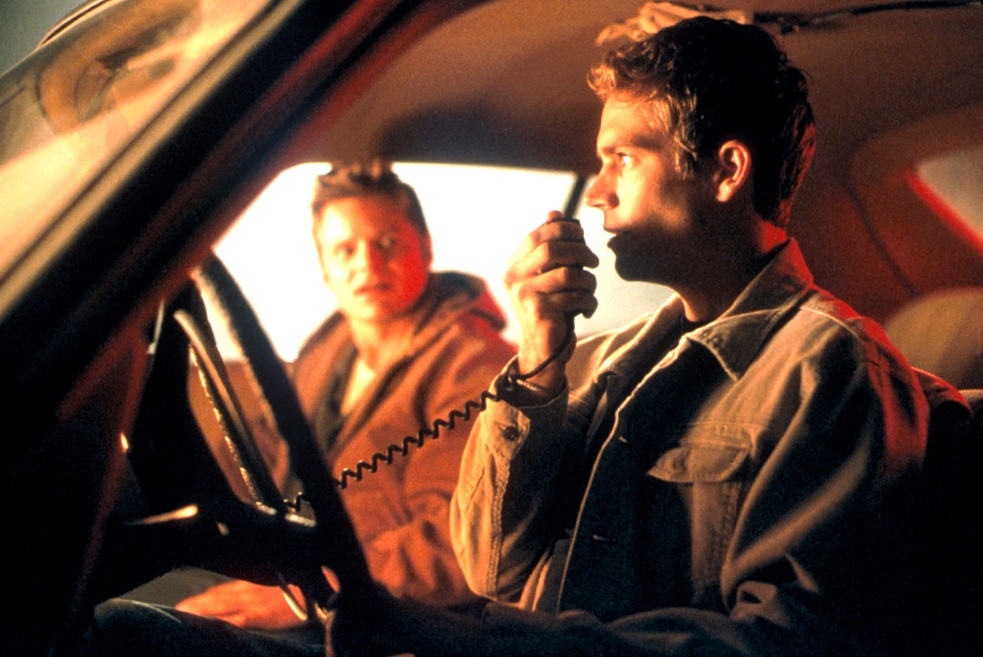 Brothers Steve Zahn and Paul Walker fool around with a CB radio in Joy Ride (2001)