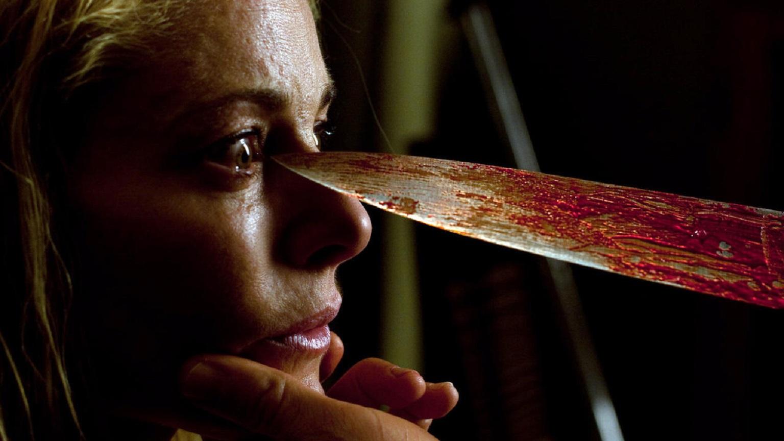 An unseeing Belen Rueda menaced by the killer in Julia's Eyes (2010)