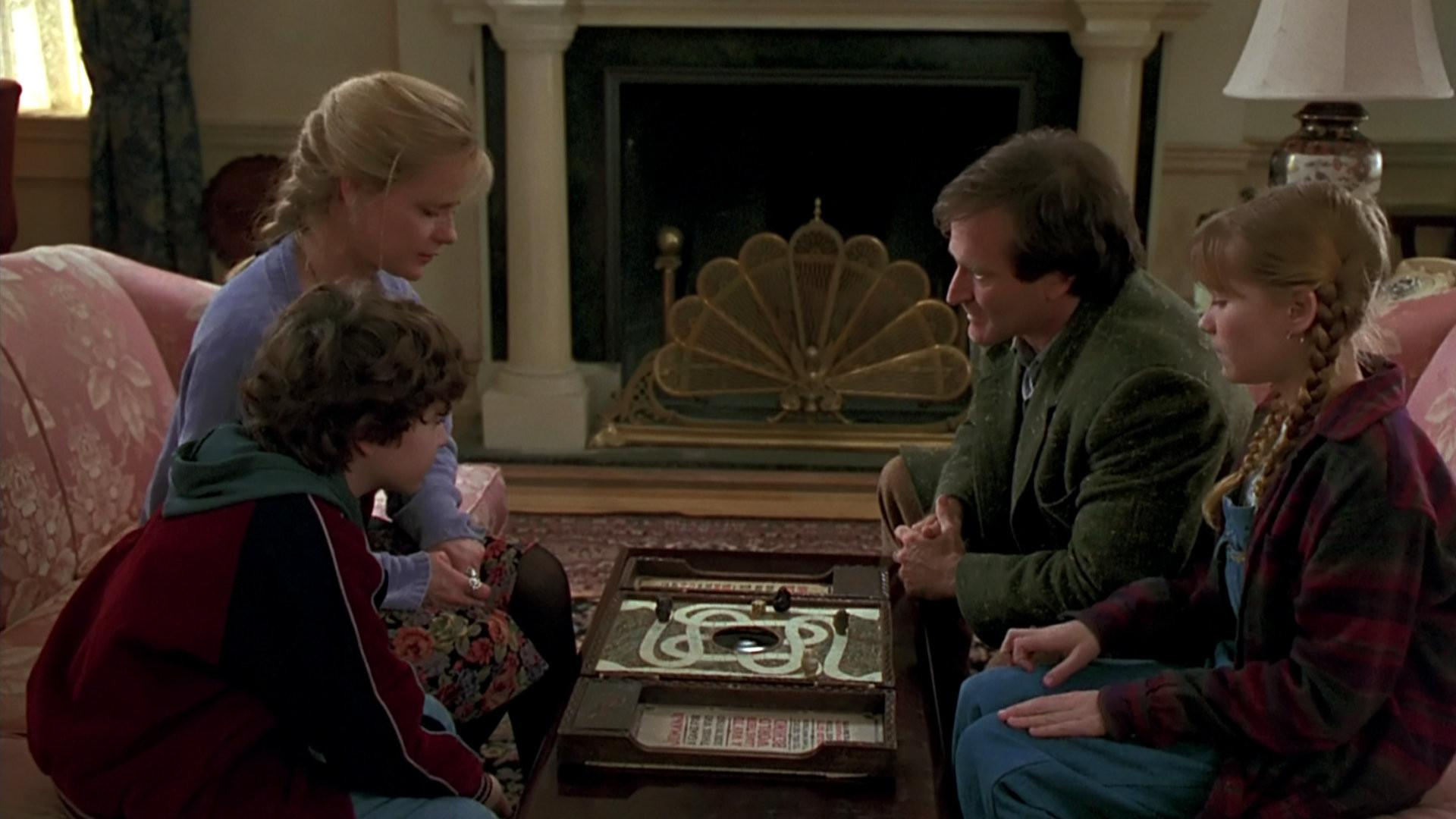 Sitting down to play the boardgame - Bradley Pierce, Bonnie Hunt, Robin Williams, Kirsten Dunst in Jumanji (1995)