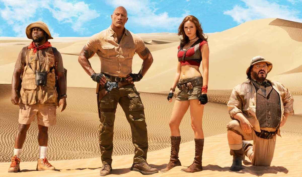Franklin 'Mouse' Finbar (Kevin Hart), Dr Xander Bravestone (Dwayne Johnson), Ruby Roundhouse (Karen Gillan) and Professor Sheldon Oberon (Jack Black) in Jumanji: The Next Level (2019)