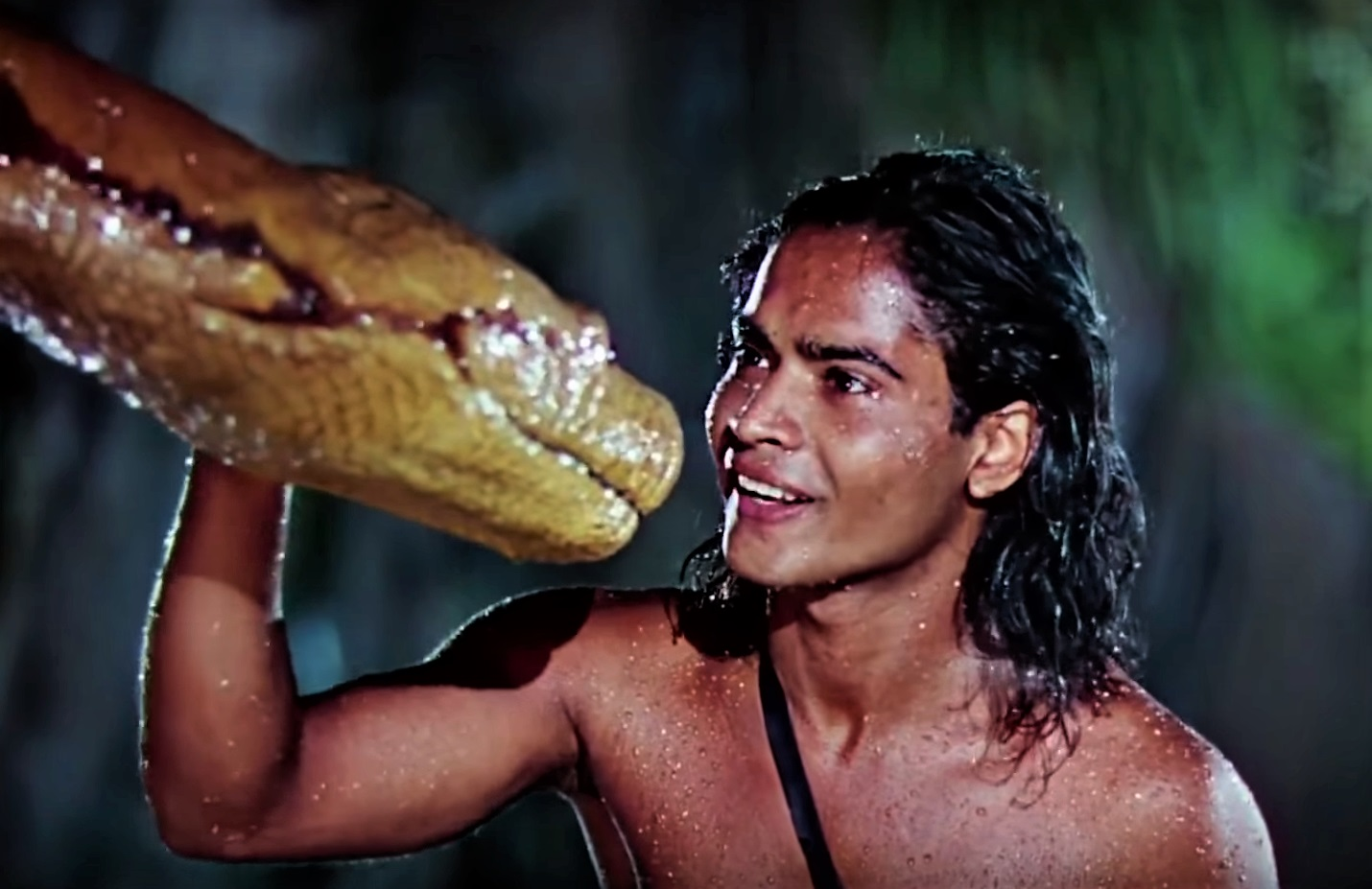 Mowgli (Sabu) and the snake Kaa in Jungle Book (1942)