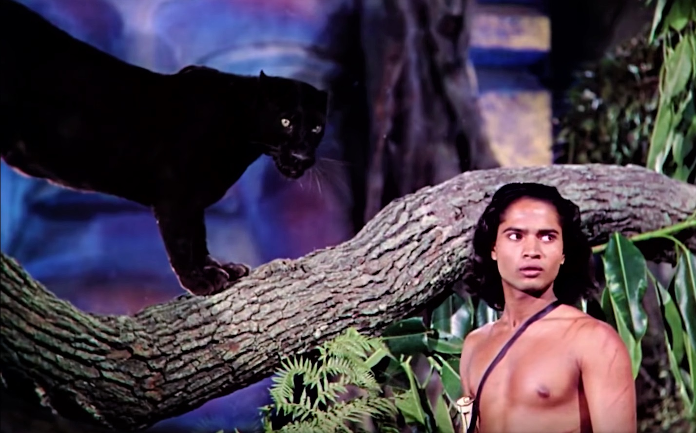 Mowgli (Sabu) and the panther Bagheera in Jungle Book (1942)