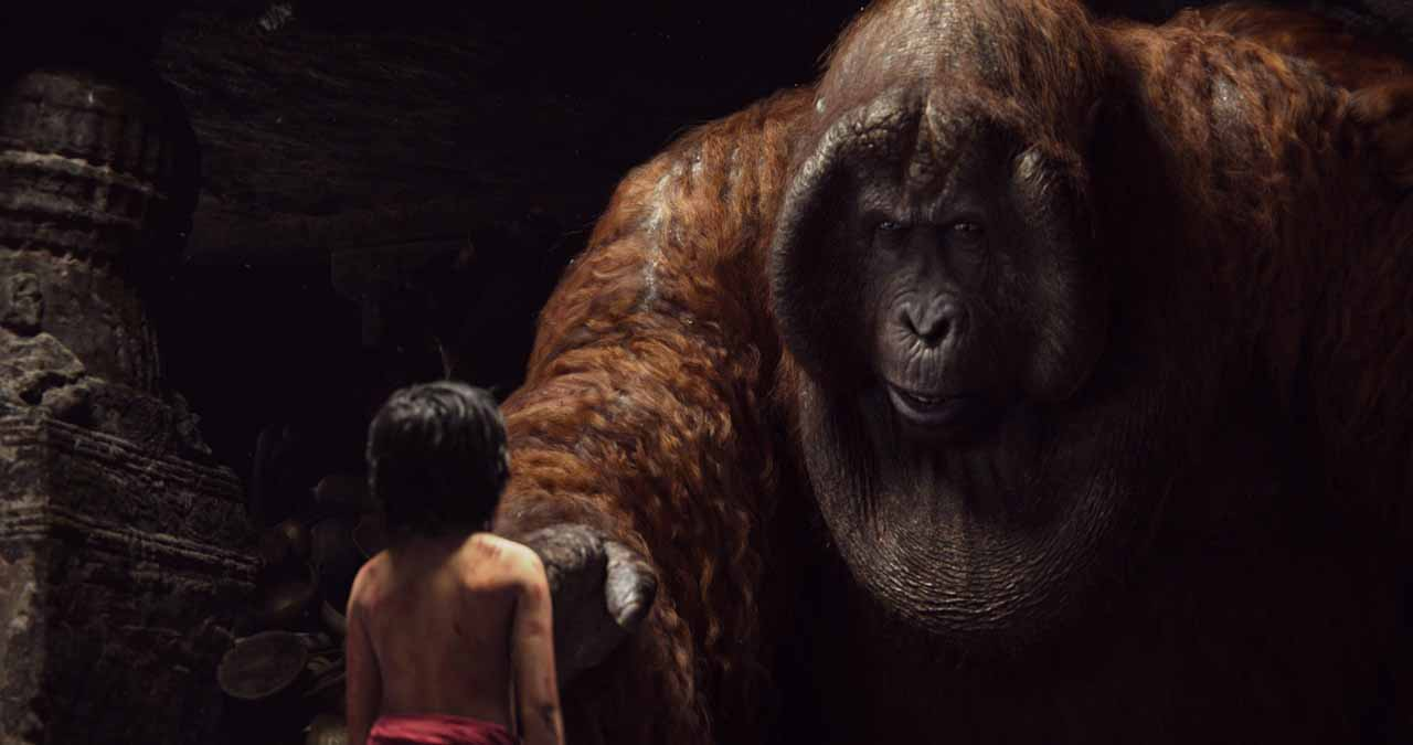 Mowgli (Neel Sethi) meets King Louie (voiced by Christopher Walken) in The Jungle Book (2016)