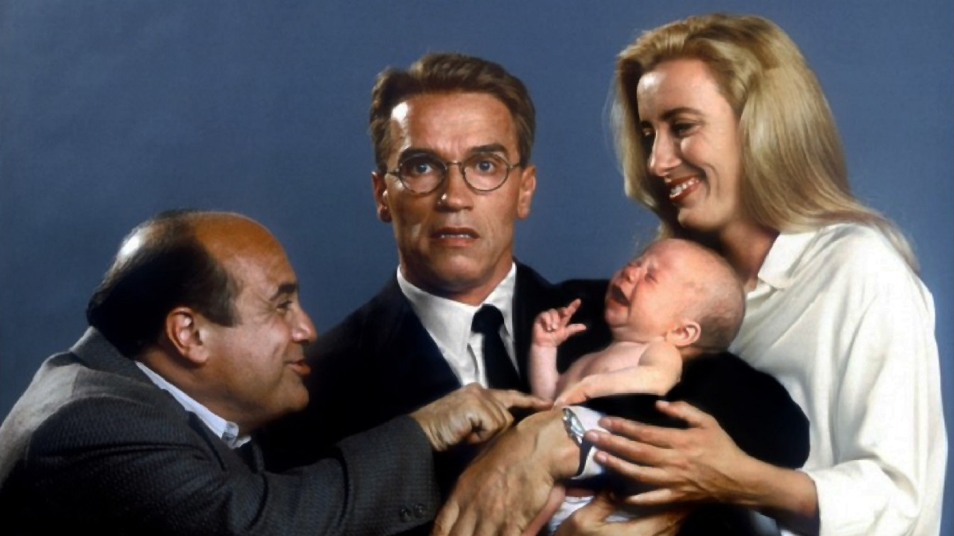 Publicity shot - (l to r) Danny DeVito, Arnold Schwarzenegger and his baby, and Emma Thompson in Junior (1994)