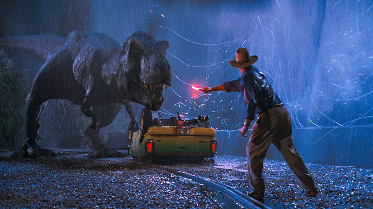 Sam Neill distracting the T-Rex with a flare in Jurassic Park (1993)