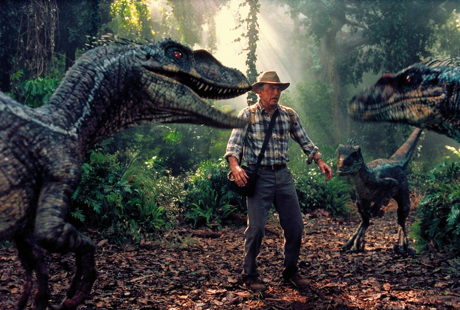 Sam Neill surrounded by velociraptors in Jurassic Park III (2001)