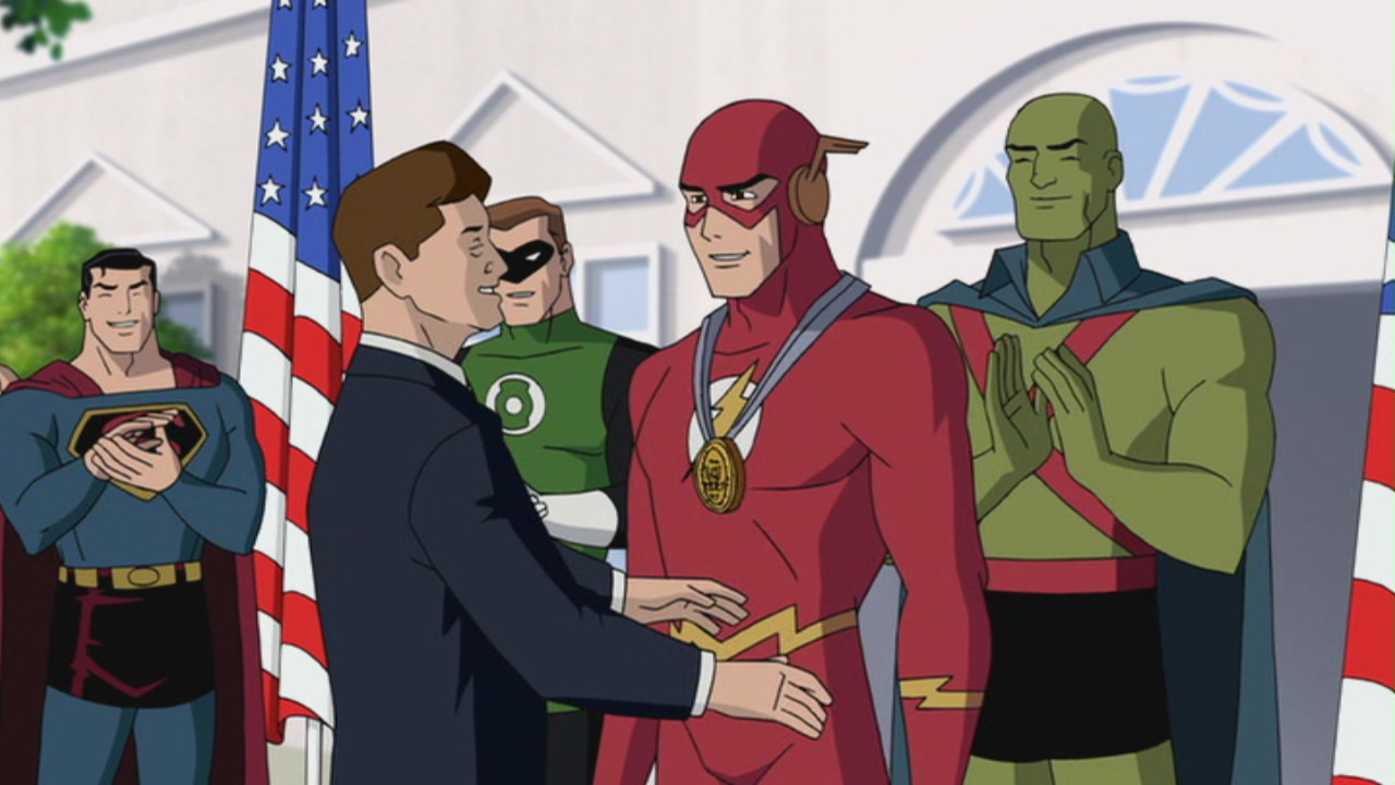 President Kennedy presents The Flash with a medal flanked by Superman, Green Lantern and J'onn J'onnz in Justice League: The New Frontier (2008)