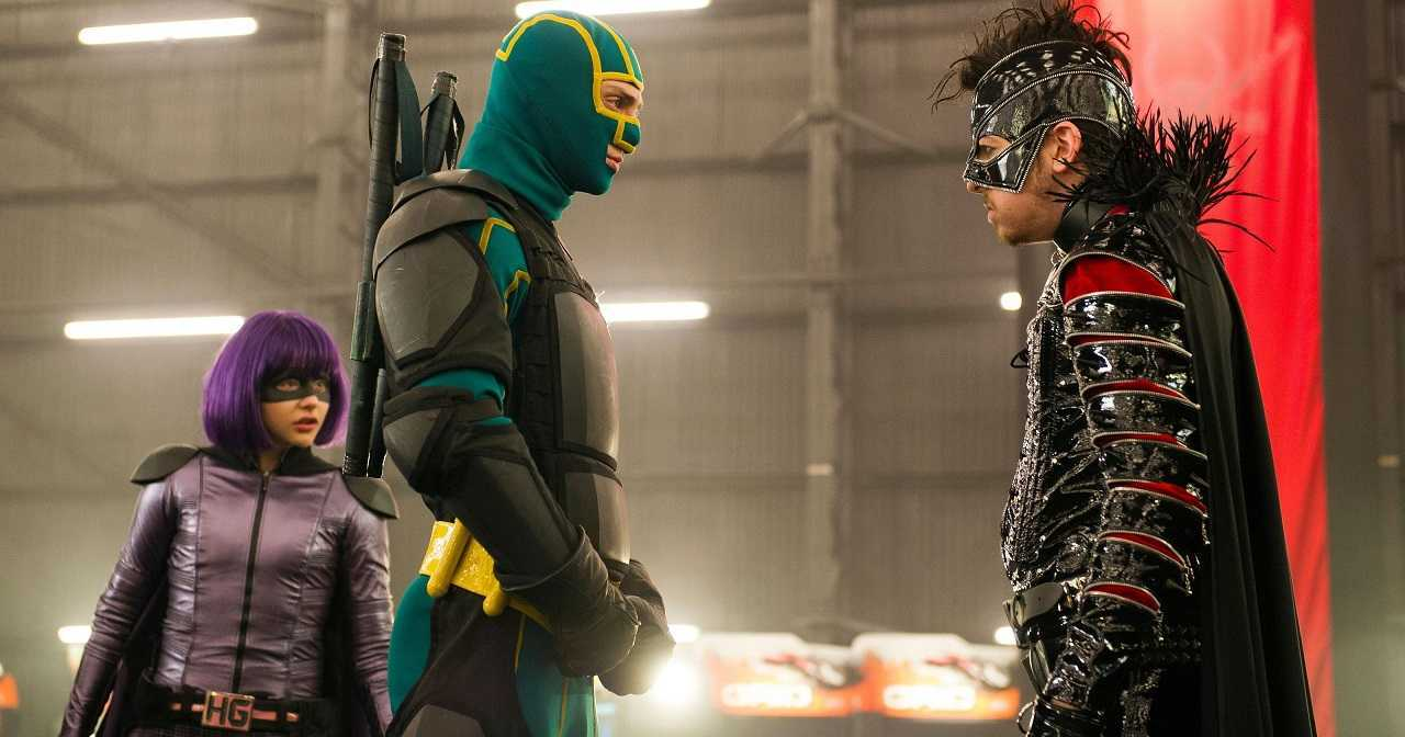 (l to r) Mindy Macready/Hit Girl (Chloe Grace Moretz) and Dave Lizewski/Kick-Ass (Aaron Taylor-Johnson) up against villain Chris D'Amico/The Mother Fucker (Christopher Mintz-Plasse) in Kick-Ass 2 (2013)
