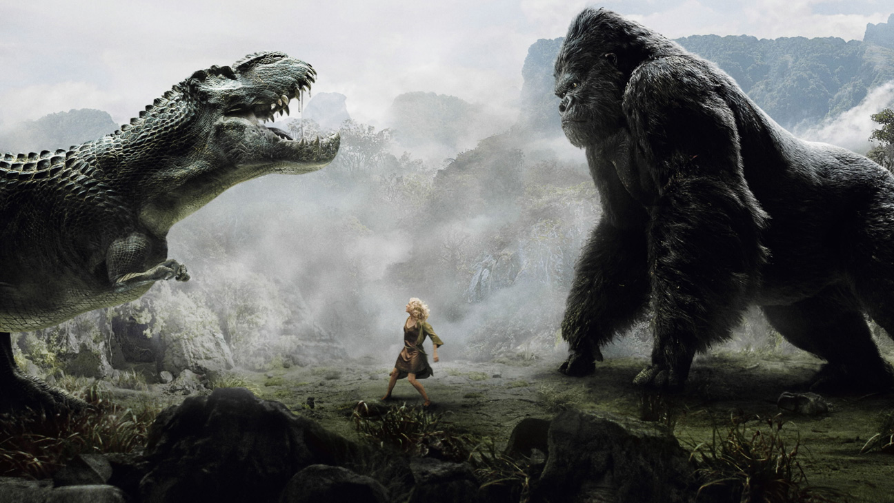 Kong vs dinosaur on Skull Island with Ann Darrow (Naomi Watts) in the middle in King Kong (2005)