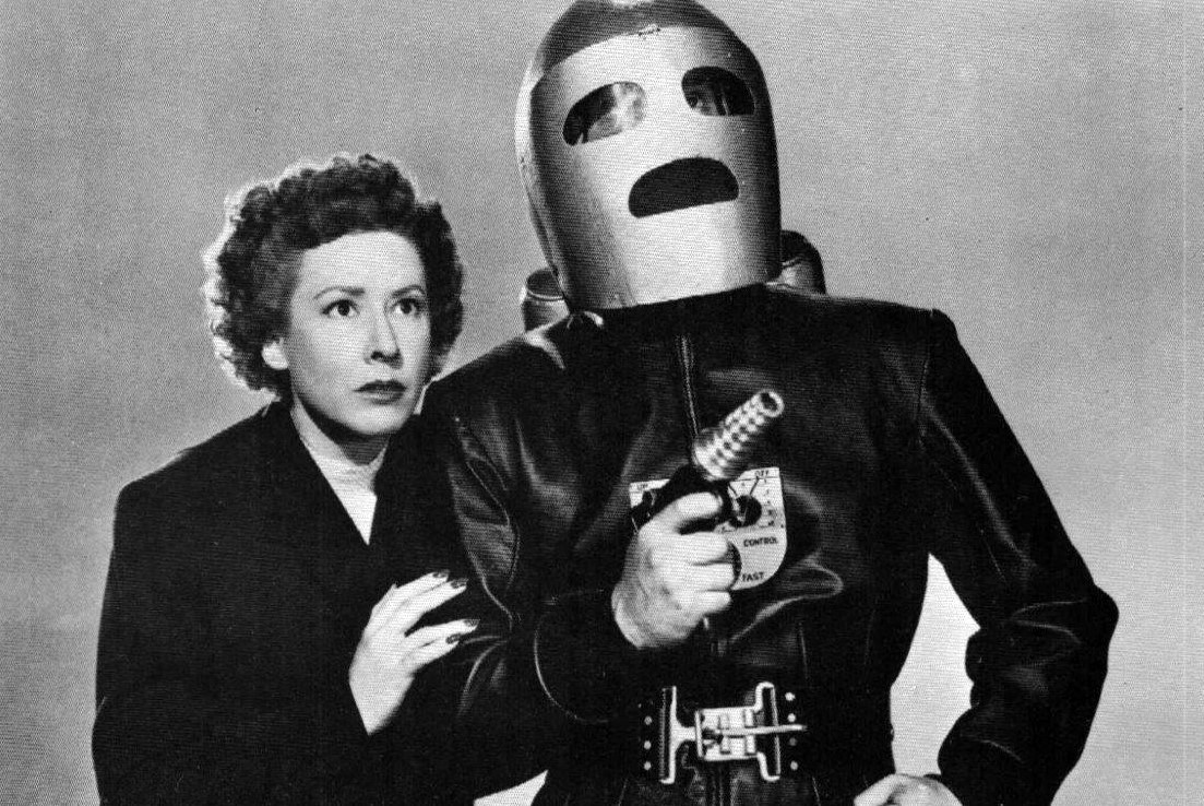 Jeff King in his guise as the Rocket Man (Tristram Coffin) and girlfriend Glenda Thomas (Mae Clarke) in King of the Rocket Men (1949)