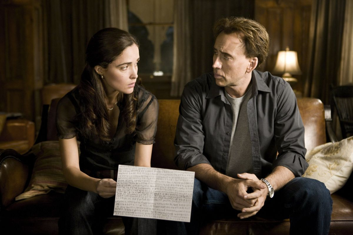 Rose Byrne and Nicolas Cage interpret the numbers from the time capsule in Knowing (2009)