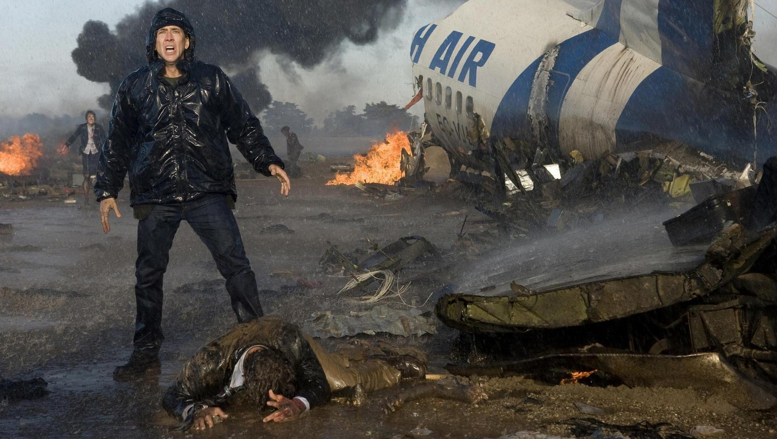 Nicolas Cage at the site of an airline disaster in Knowing (2009)