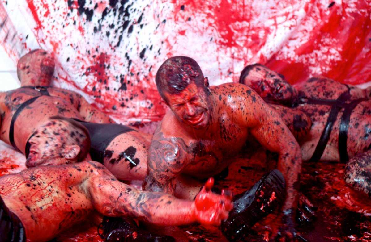 Gore-drenched orgy among a group of leather boys in L.A. Zombie (2010)