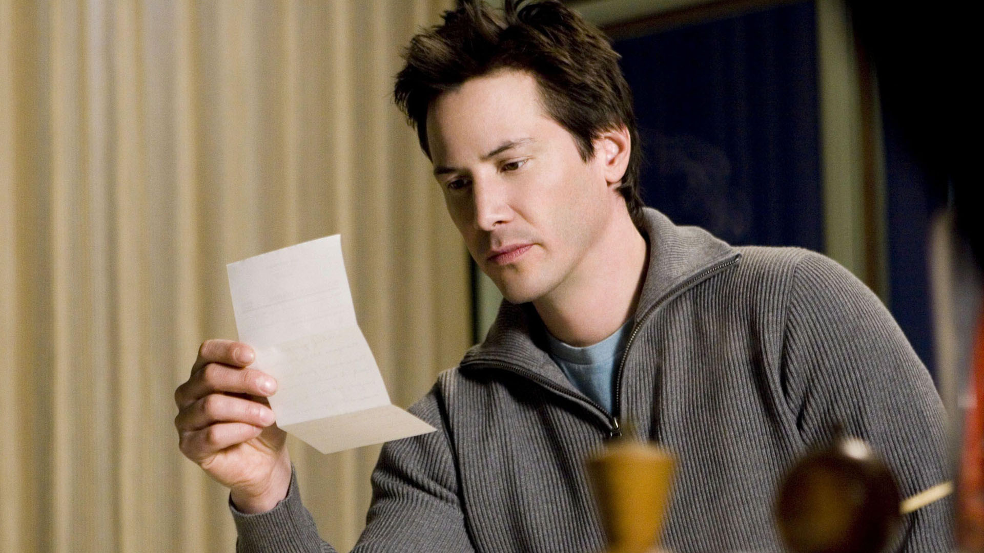 Keanu Reeves receives letters sent across time in The Lake House (2006)