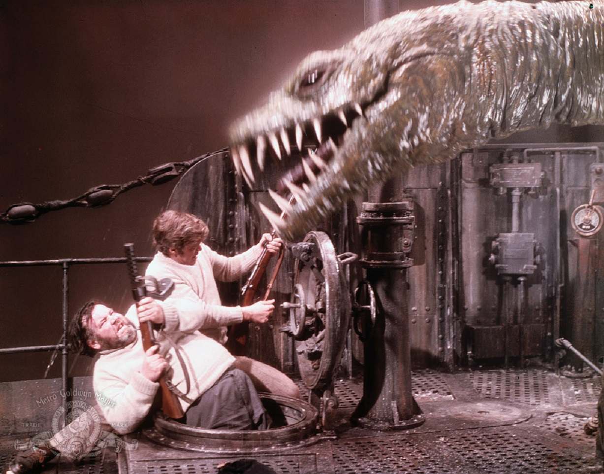Declan Mulholland and Doug McClure fight off a dinosaur aboard the submarine in The Land That Time Forgot (1974)
