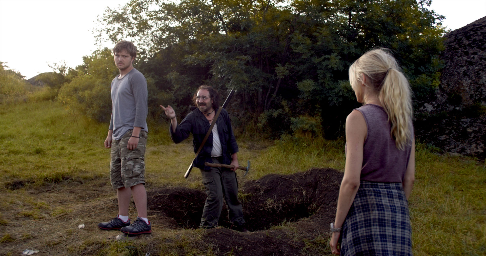 (l to r) Sterling Knight stands on the mind while Kote Tolordava taunts from the hole and girlfriend Spencer Locke watches on in Landmine Goes Click (2015)