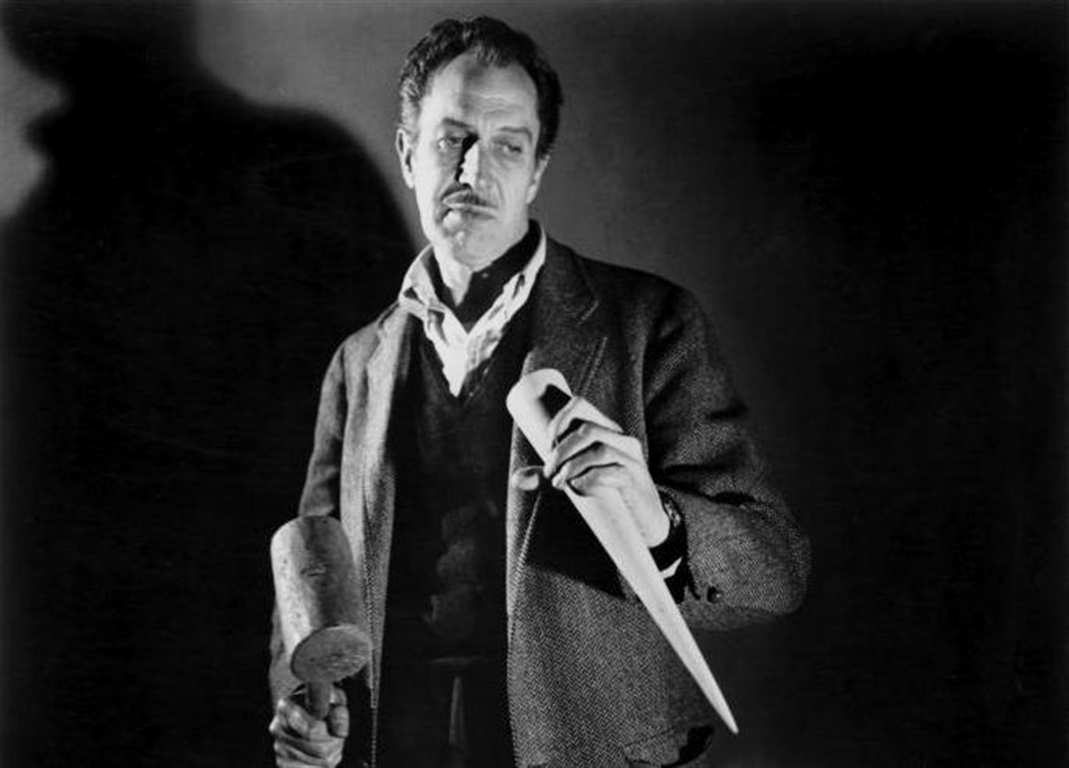 Robert Neville (Vincent Price) stakes vampires in The Last Man on Earth (1964)