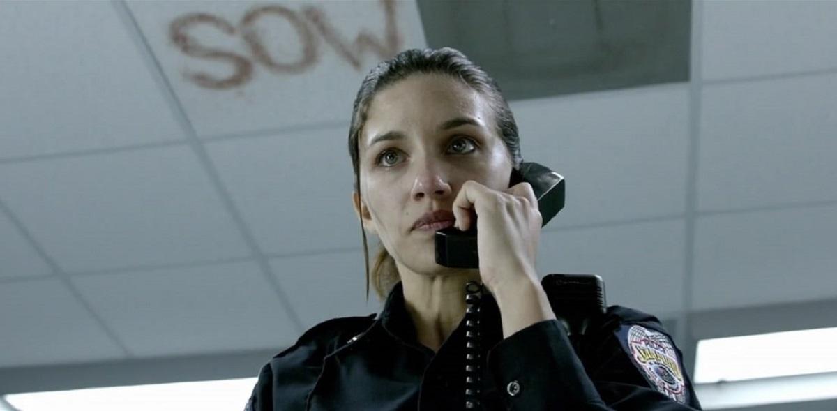 Rookie cop Juliana Harkavy left alone on duty in an abandoned police station in Last Shift (2014)