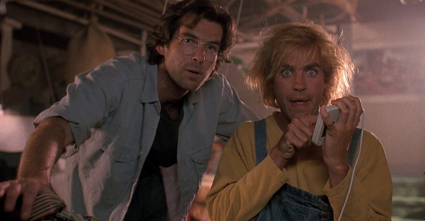 (l to r) Scientist Dr Lawrence Angelo (Pierce Brosnan) introduces his handicapped gardener Jobe (Jeff Fahey) to Virtual Reality in The Lawnmower Man (1992)