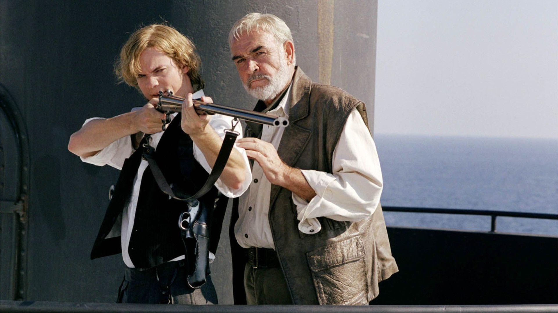 Allan Quatermain (Seam Connery) teaches Tom Sawyer (Sane West) to shoot in The League of Extraordinary Gentlemen (2003)