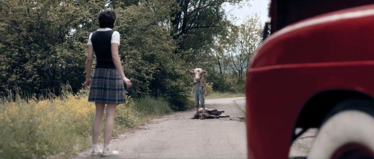 Lorina Kamburova encounters the young Jed (Boris Kabakchiev) in Leatherface (2017)