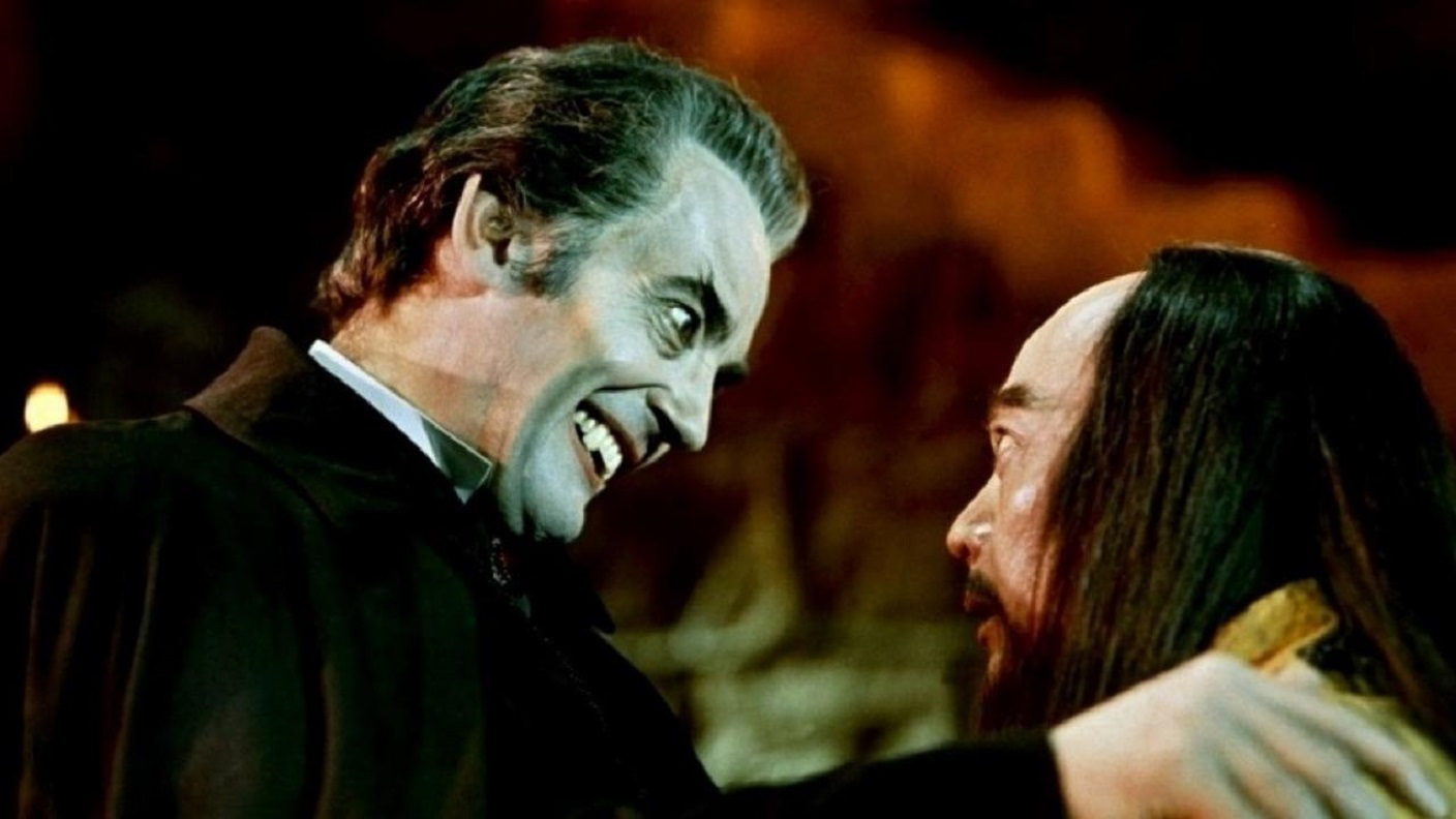 Dracula (John Forbes-Robertson) puts the bite on Kah (Chan Shen) in The Legend of the 7 Golden Vampires (1974)