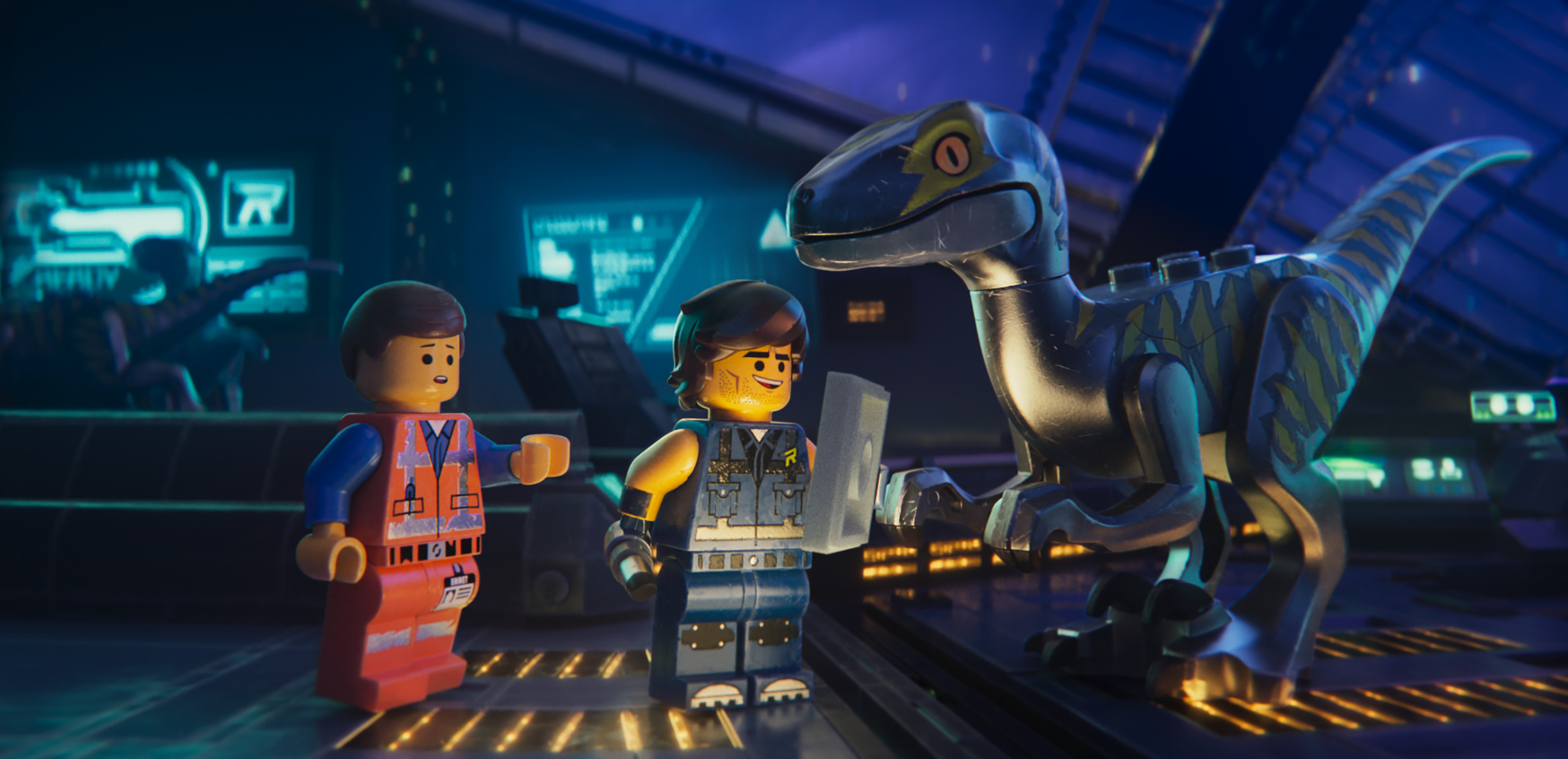 Emmet meets Rex Dangervest (both voiced by Chris Pratt) and one of Rex's trained raptors in The Lego Movie 2 (2019)
