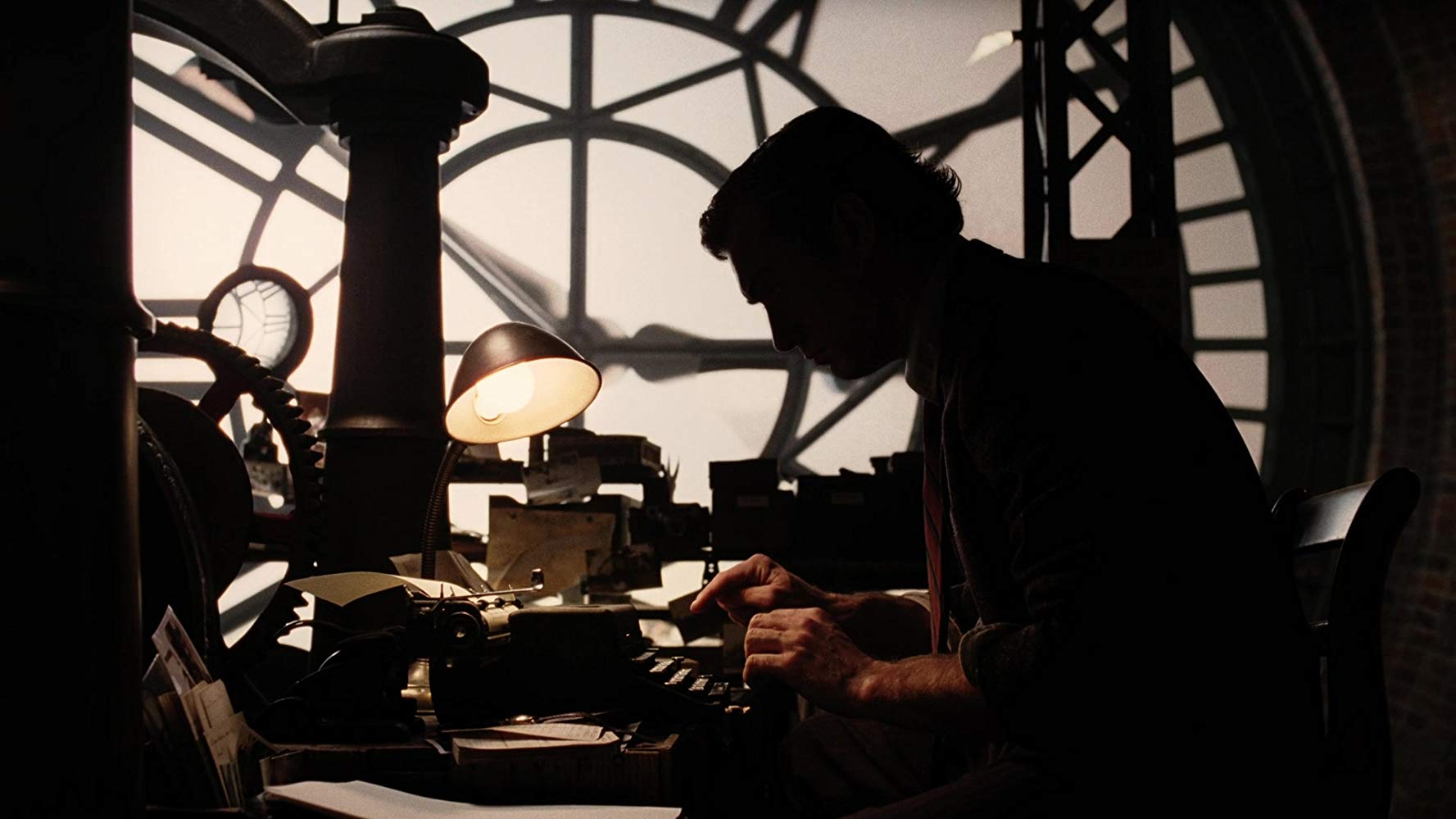 Lemony Snicket (Jude law) sits writing in his clocktower in Lemony Snicket's A Series of Unfortunate Events (2004)