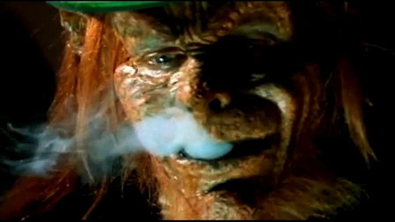 The Leprechaun (Warwick Davis) enjoys a spliff in Leprechaun in the Hood (2000)