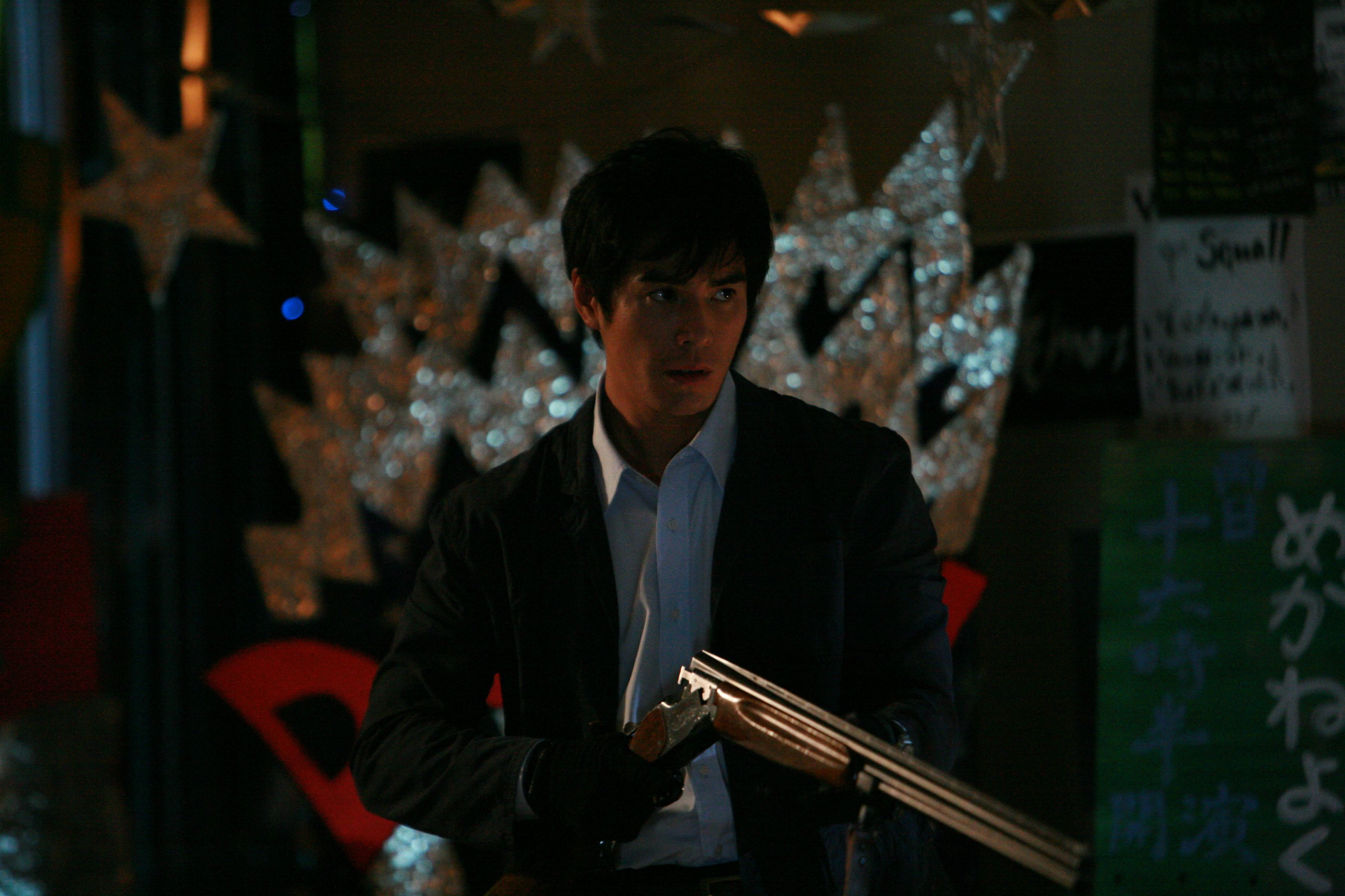 Teacher Hideaki Ito readies his shotgun in Lesson of the Evil (2012)
