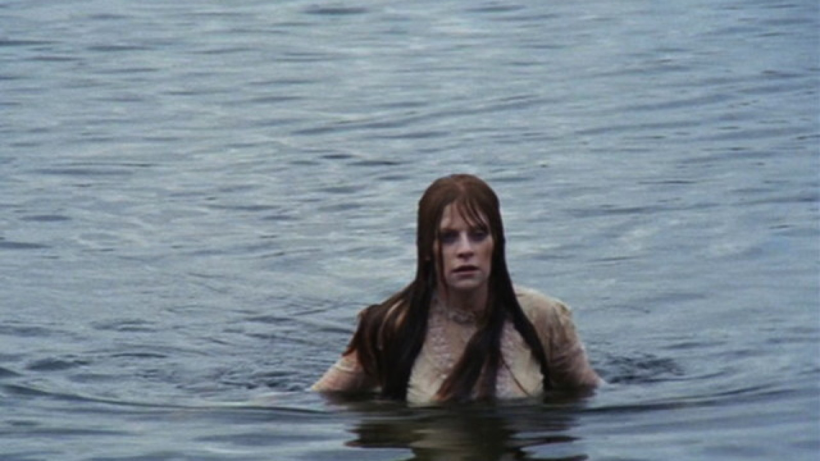Mariclare Costello rises from the lake in Let's Scare Jessica to Death (1971)