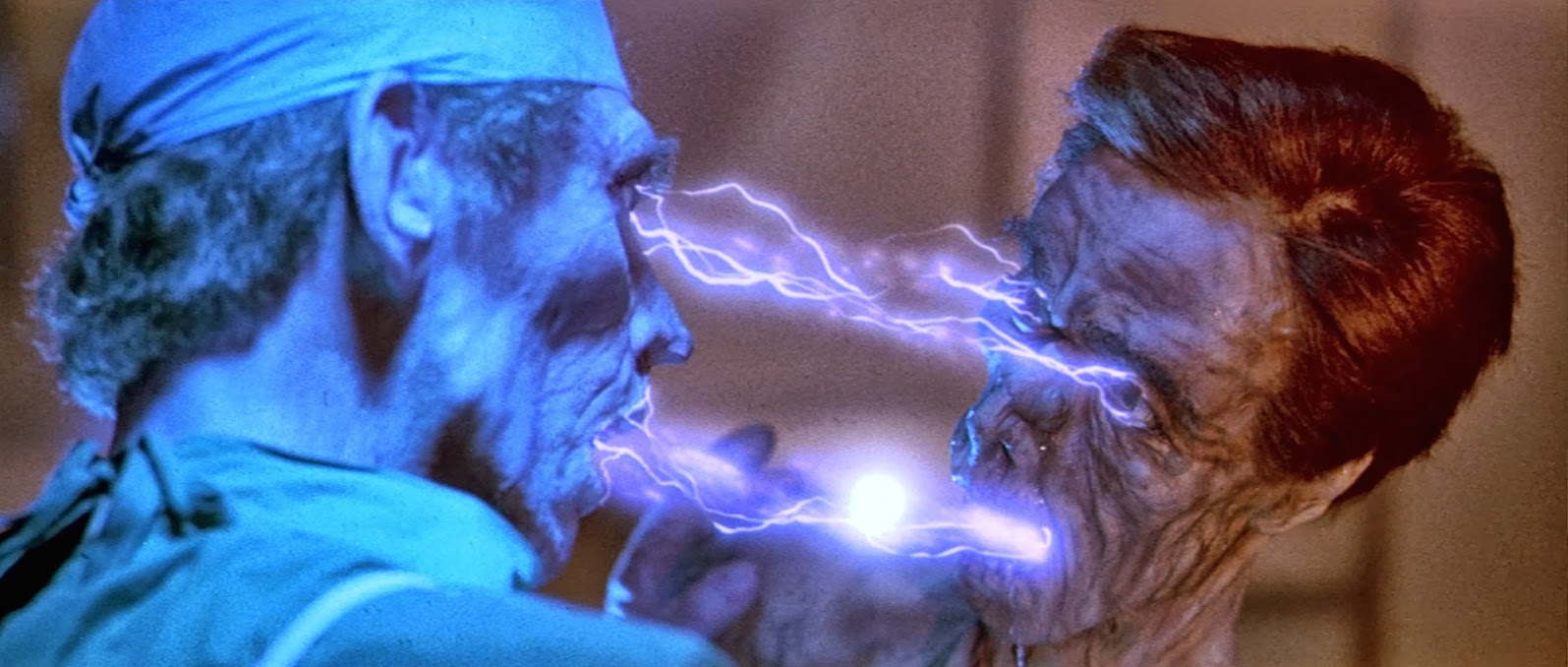 One of the space vampires sucks out a victim's lifeforce in Lifeforce (1985)
