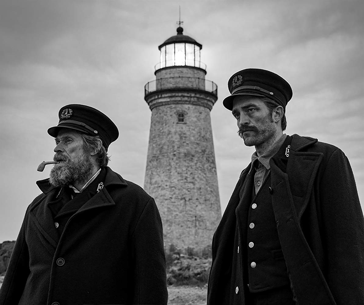 (l to r) Lighthouse keeper Thomas Wake (Willem DaFoe) and new assistant Ephraim Winslow (Robert Pattinson) in The Lighthouse (2019)