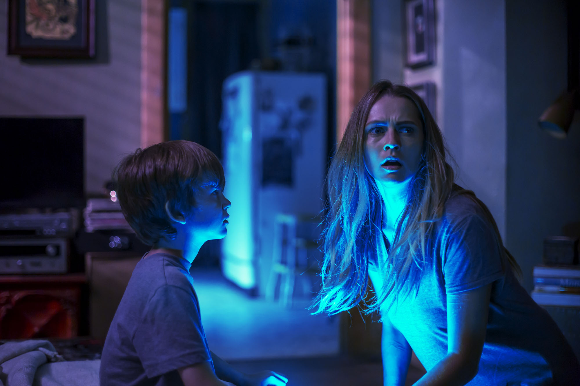 Gabriel Bateman and Teresa Palmer fear the dark in Lights Out (2016)