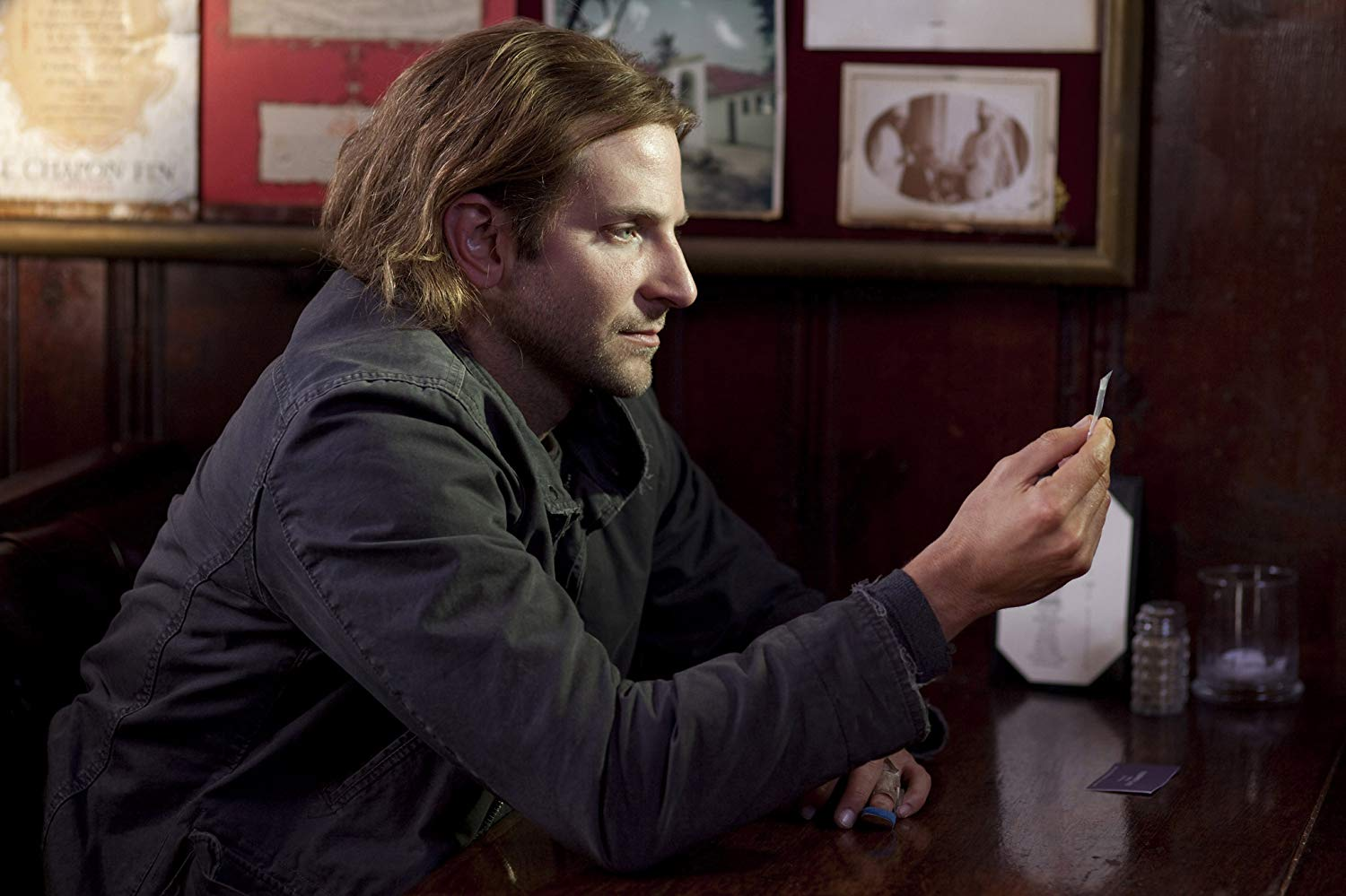 Bradley Cooper as the down-and-out loser contemplating the intelligence-expanding drug NZT-48 in Limitless (2011)