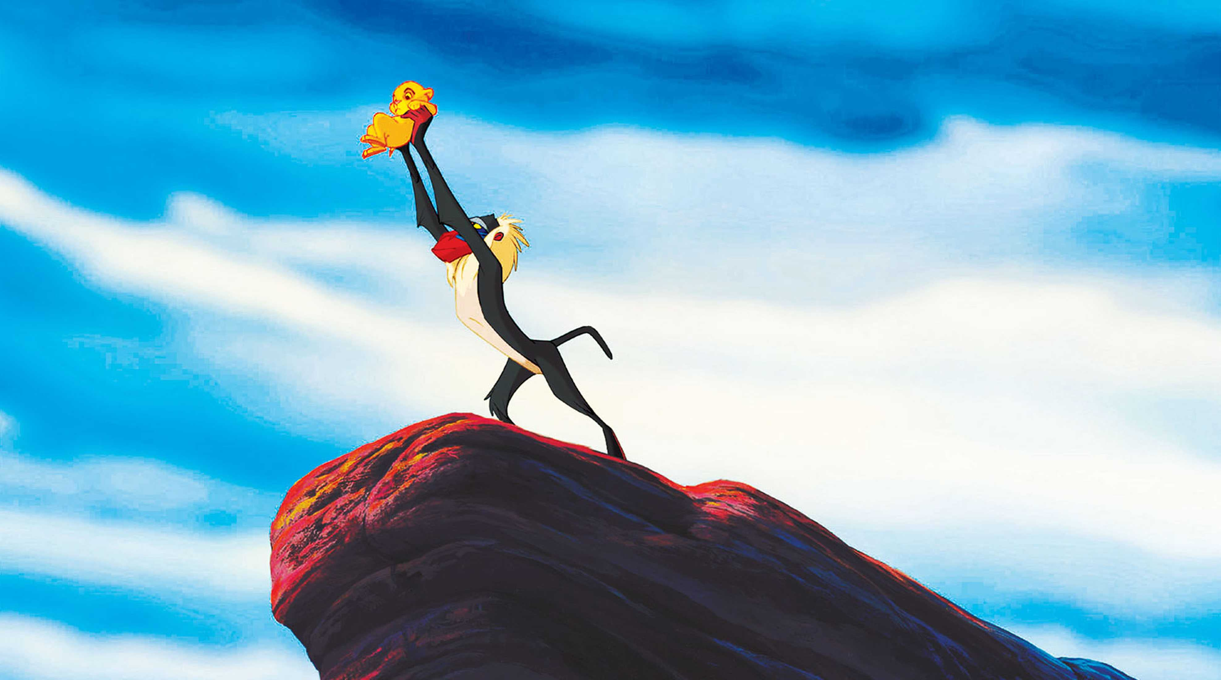 Rafiki holds the infant Simba up over Pride Rock in The Lion King (1994)