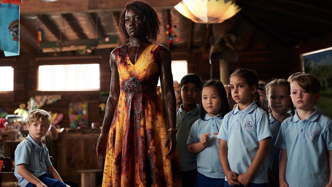 Miss Caroline (Lupita Nyong'o) guards the children from the zombie onslaught in Little Monsters (2019)