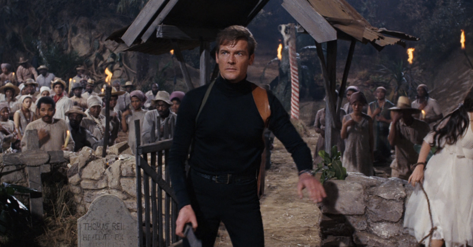 James Bond (Roger Moore) caught in the midst of a voodoo ceremony in Live and Let Die (1973)