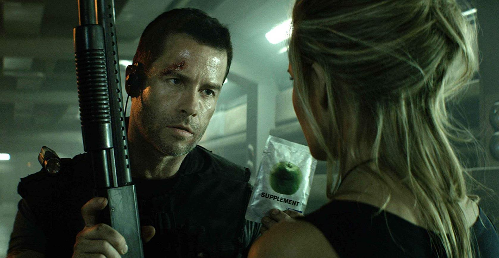 Snow (Guy Pearce) in action to save The President's daughter (Maggie Grace) in Lockout (2012)