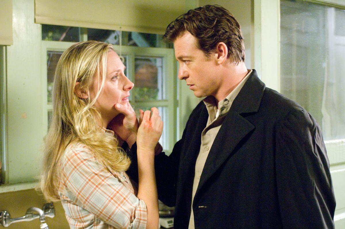 Hope Davis menaced by Simon Baker in The Lodger (2009)