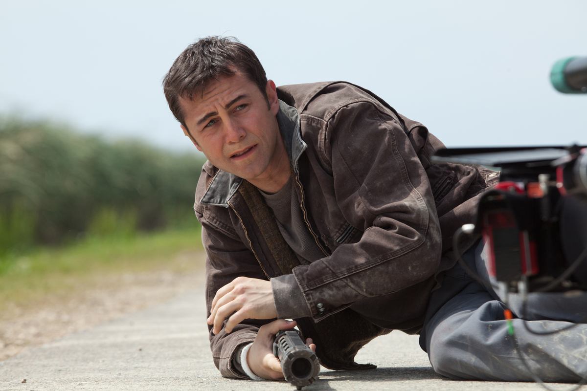 Joe (Joseph Gordon-Levitt) caught in the middle of a temporal conundrum hunting himself in Looper (2012)