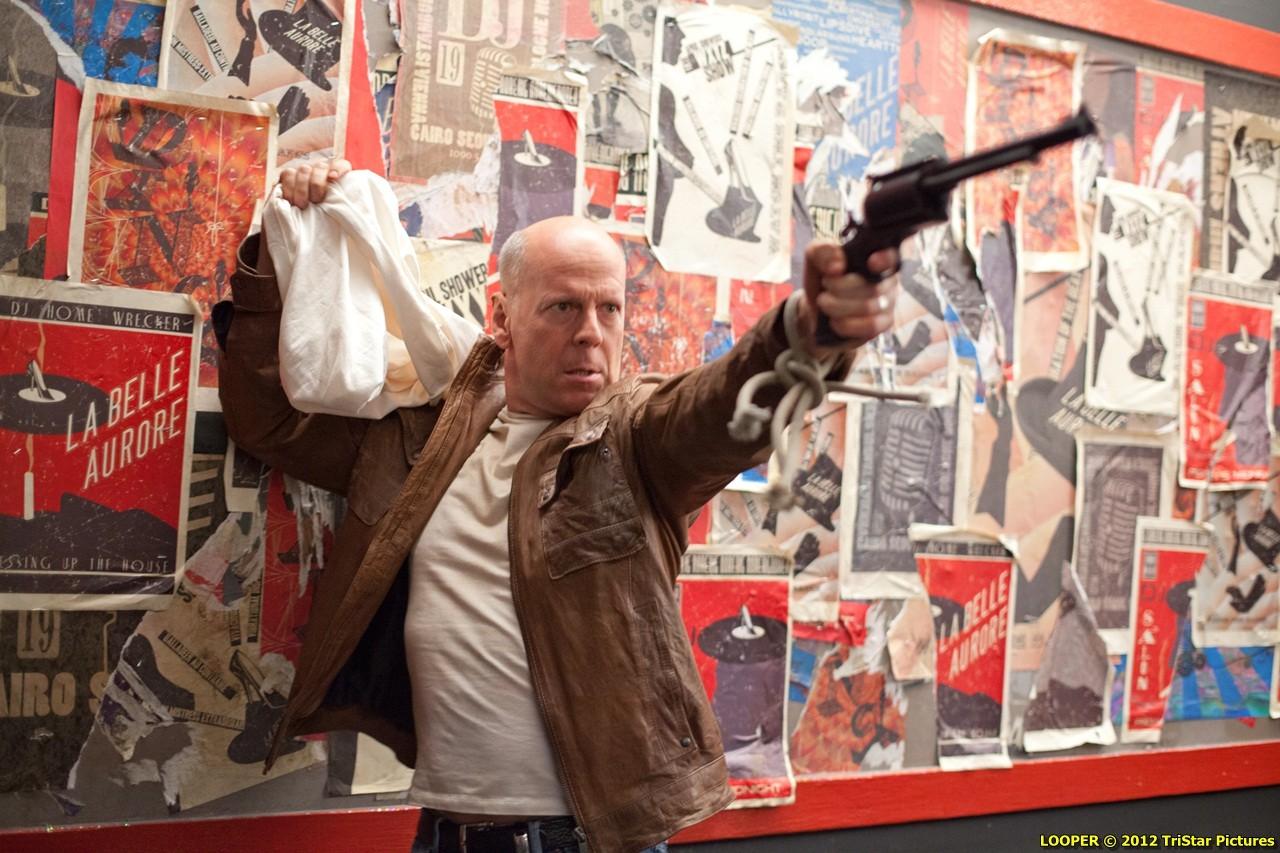 Bruce Willis as the older version of Joe in Looper (2012)