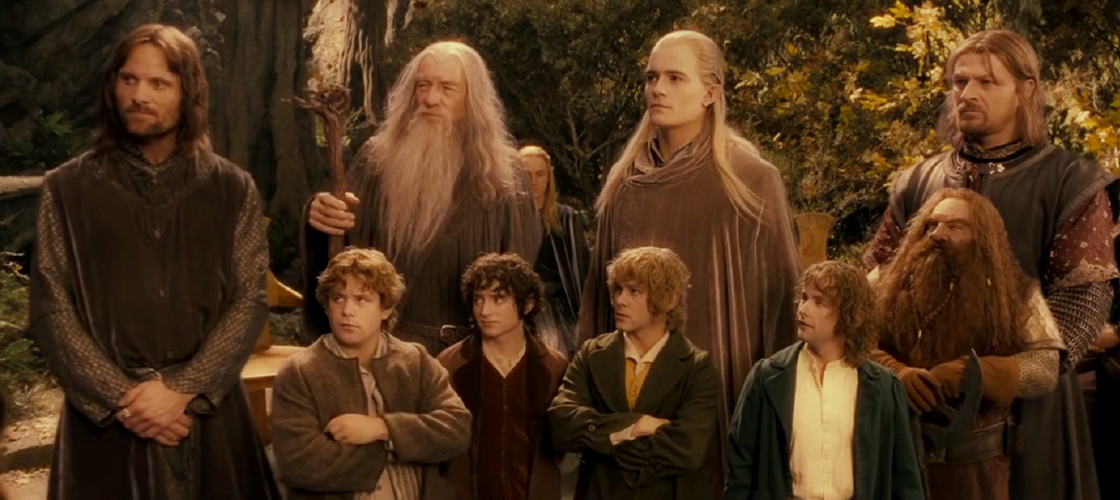 The Fellowship - Aragorn (Viggo Mortensen), Gandalf (Ian McKellen), Legolas (Orlando Bloom), Boromir (Sean Bean), Samwise Gamgee (Sean Astin), Frodo Baggins (Elijah Wood), Merry Brandybuck (Dominic Monaghan), Pippin Took (Billy Boyd) and Gimli (John Rhys-Davies) in The Lord of the Rings: The Fellowship of the Ring (2001)