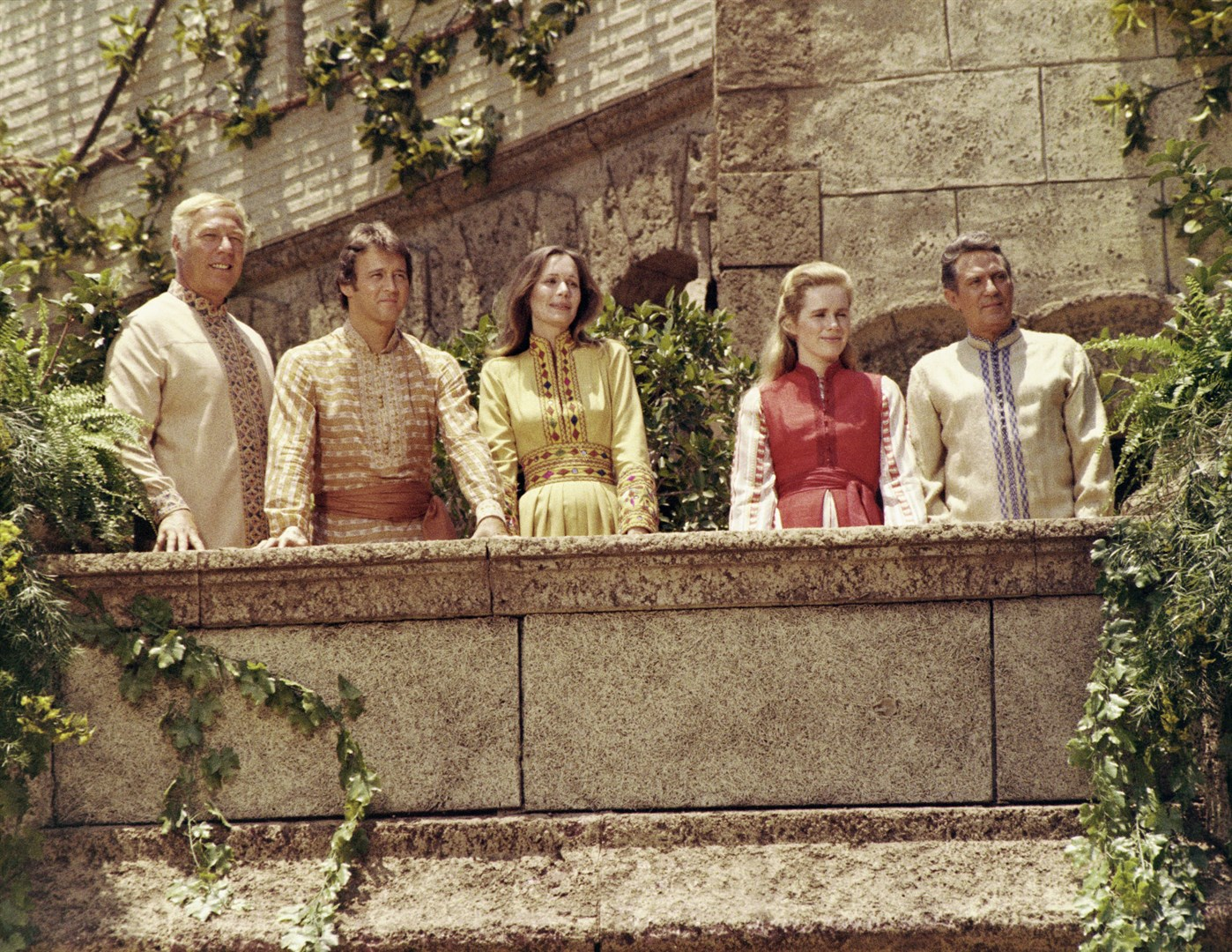 The Westerners in Shangri-La - (l to r) George Kennedy, Bobby Van, Olivia Hussey, Liv Ullman and Peter Finch in Lost Horizon (1973)