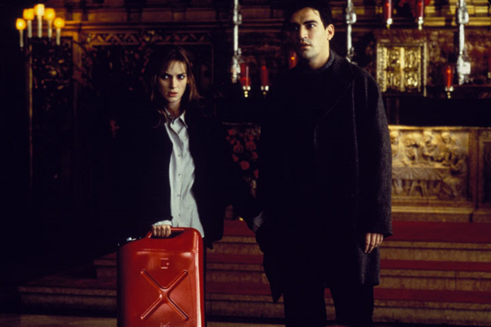 Winona Ryder and Ben Chaplin - facing the coming of the Anti-Christ in Lost Souls (2000)